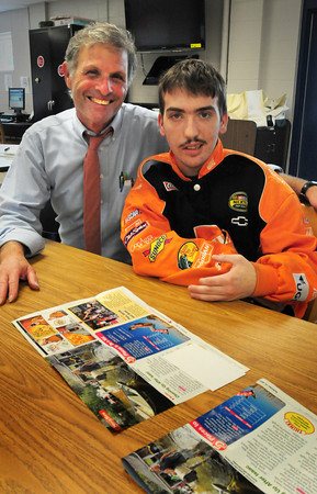 Hampton: Matt Denis, right, pictured with his teacher Stephen Lichtenstein,   was injured when hit by a car while riding his bicycle in Seabrook in April, has returned to classes at Winnacunnet High School. Bryan Eaton/Staff Photo