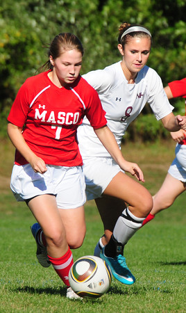 Newburyport: Masconomet's Courtney  Bouchard gets the pressure from Newburyport's Julia Kipp at Cherry Hill Field. Bryan Eaton/Staff Photo