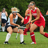 Byfield: Amesbury's Megan Kenneally, right, moves past Triton's Jessica Savage. Bryan Eaton/Staff Photo