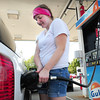 Salisbury: Melyssa Coady of Salisbury fills up her vehicle at Gulf Express in Salisbury Square for an overnight biking trip to New Hampshire with friends. Gas prices have been inching up with some concern of the effect of Hurrican Isaac on oil refineries. Bryan Eaton/Staff Photo