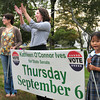 Newburyport: Candidate for state senate Kathleen O'Connor Ives, center, waves to motorists at Three Roads in Newburyport with supporters Leslie Siewko, left, and non-voting Lucy Cameron, 6. Bryan Eaton/Staff Photo
