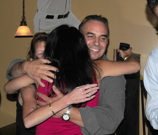 Georgetown: Lenny MIrra, who won the state senate seat held by retiring Harriet Stanley, gets a hug from his sister Sandra Capo, back to camera, and girlfriend Cindy Vachon, left, last night after getting final results. Bryan Eaton/Staff Photo