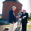 Newburyport: State Rep. Michael Costello, right, gives the key to the Powder House to Thomas Kolterjahn, co-chairman of the Newburyport Powder House Restoration Committee during a dedication ceremony yesterday. Bryan Eaton/Staff Photo