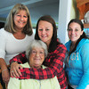Seabrook: Sarah Adams gives a hug to her memere (grandmother) Sylvia Bouchard, flanked by her aunt Robin Patria, left, and friend Breann Nadeau. Adams is in the US Marine Corps and just came back from an 8 month tour of Afghanistan. Bryan Eaton/Staff Photo