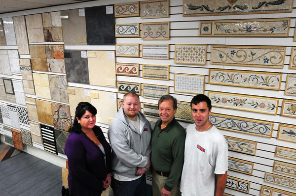 Newburyport: Tiles Gone Wild staff from left, Lisa McCarthy, Chris Bates, Arthur Bates and Sam Boylston. Bryan Eaton/Staff Photo