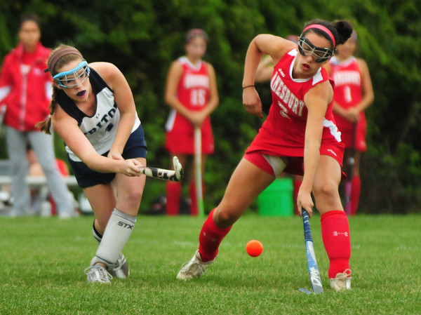 Byfield: Triton's Emily Hirtle, left, shoots past Amesbury's Amanda Schell. Bryan Eaton/Staff Photo