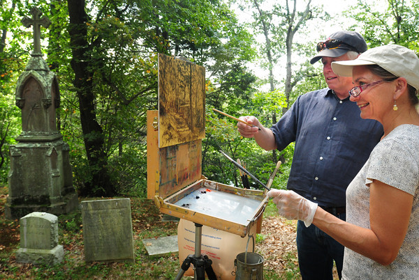 Newburyport: Donald Jurney gives lighting tips to Pam Perras of Wakefield at the Oak  Hill Cemetery in Newburyport. The well-known artist, who gives classes in the plein air style, often takes his students to the wooded burial ground. Bryan Eaton/Staff Photo
