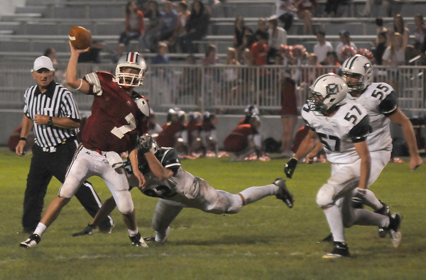 Amesbury: Amesbury quarterback Matt Talbot makes a throw under pressure during teh Indian's game against Manchester Essex at Amesbury Friday night. JIm Vaiknoras/staff photo