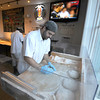Newburyport: Sean Tebbetts of Amesbury makes dough at the Upper Crust in Newburyport. Jim Vaiknoras/staff photo