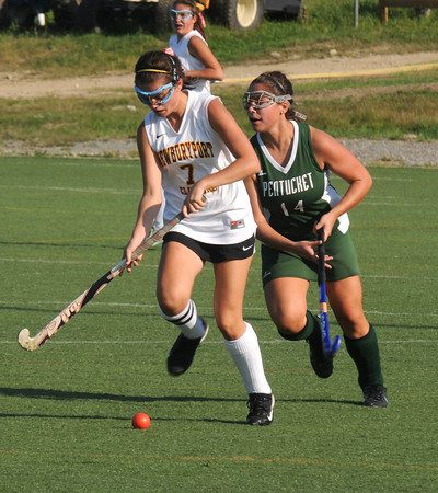 Amesbury: Newburyport's Paige Hefferan  fights for the ball with Pentucket's Jenna Raimandi during their game at Amesbury Sports Park Friday. Jim Vaiknoras/staff photo