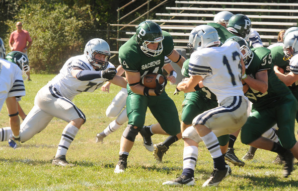 West Newbury: Pentucket's Tim Freirmuthruns through the line during the Sachem's game at home against Hamilton Wenham Saturday. Jim vaiknoras/staff photo