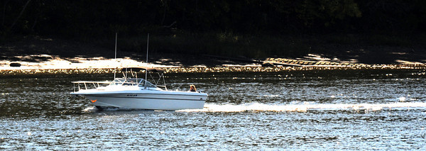 Amesbury: Bright autumn sunshine sparkles of the Merrrimack River as a boat glides along on a crisp Sunday afternoon. Jim Vaiknoras/staff photo