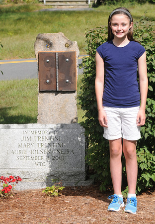 Rowley: Isabella Lesinski poses next to the partly completed 9/11 memorial in Rowley. She will be reading a poem she has written at it's dedication Saturday. Jim Vaiknoras/staff photo