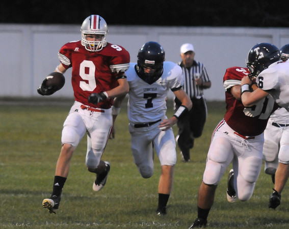 Amesbury: Amesbury's Pat Scanlon breaks away from a Lynnfield defender on a long kickoff return Friday night at Landry Stadium in Amesbury. Jim Vaiknoras/staff photo