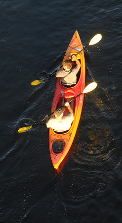 Newburyport: Two men in a tandem kayak make their way down the Merrimack River near the Chain Bridge in Amesbury. JIm Vaiknoras/staff photo