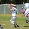 West Newbury: Hamilton Wenham's Trevor Lyons looks for a reciever during the General game at Pentucket  Saturday. Jim Vaiknoras/staff photo