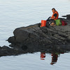 Newburyport: A man rests as he fishes off Deer Island in Amesbury Thursday. jim Vaiknoras/staff photo