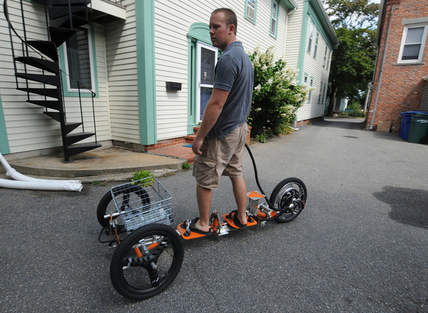 newburyport: Inventer Robert Worobey on his tribey at his Newburyport home. Jim Vaiknoras/staff photo
