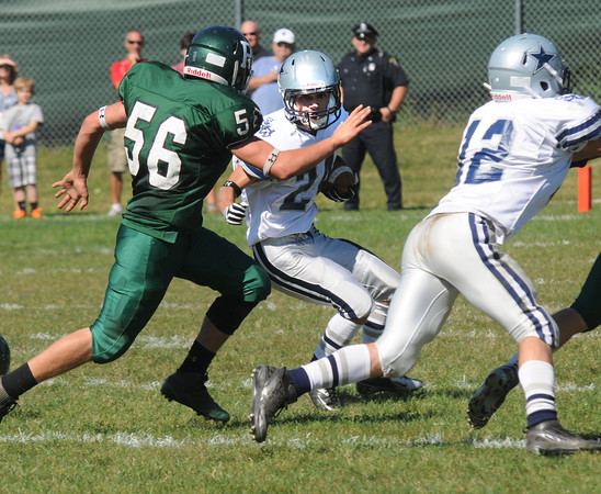 West Newbury: Hamilton Wenham's Steven Turpin looks for running room during the General game at Pentucket  Saturday. Jim Vaiknoras/staff photo