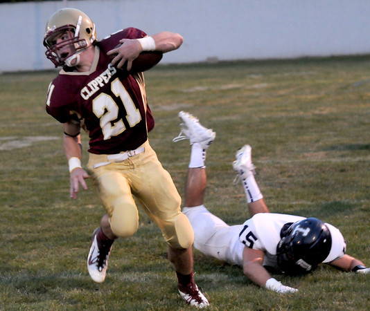 Newburyport: Newburyport's Tyler Cusack breaks a tackle during the Clippers game at home against Lynnfield. Jim Vaiknoras/staff photo