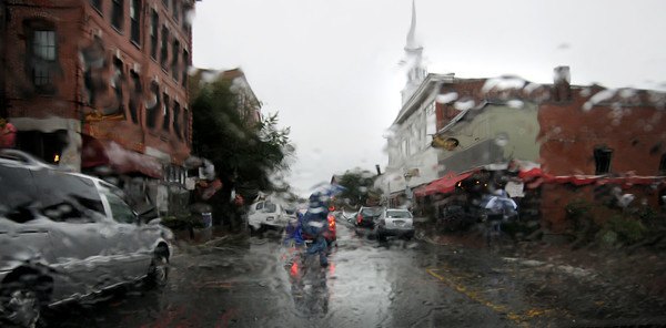 Newburyport: A family rushes across a rain soaked Pleasent Street in Neburyport Sunday morning. Jim Vaiknoras/staff photo
