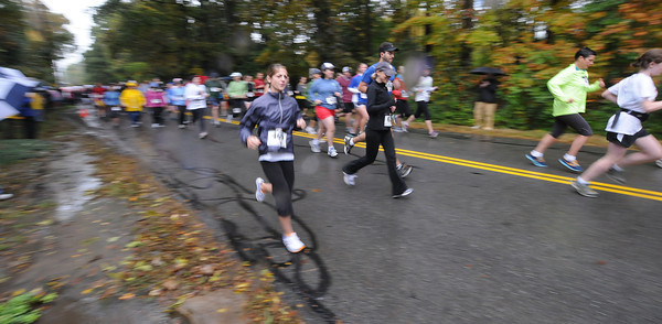 West Newbury: Runners take off in the rain at the annual Apple Harvest Road Race in West Newbury Sunday morning. JIm Vaiknoras/staff photo