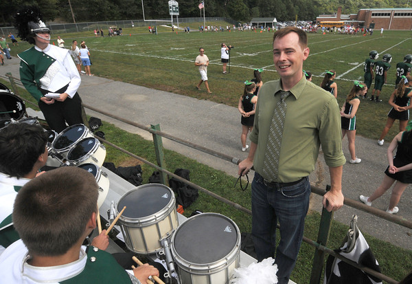 West Newbury: New Pentucket Music Director Bobby Rathbone with the marching band at their football game saturdat against Marblehead. JIm Vaiknoras/staff photo