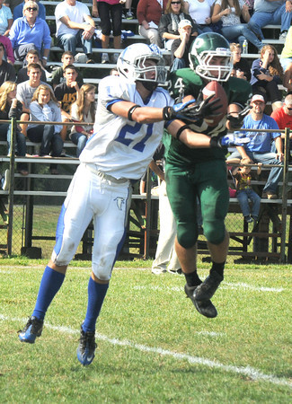 West Newbury: Pentucket's Cody Rothwell breaks up a pass intended for Alex Valles during the Sachem's home game against Danvers Saturday. Jim Vaiknoras/staff photo