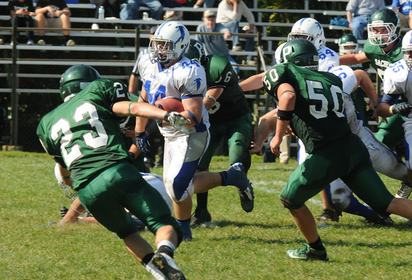 West Newbury: Danvers's Alex Grant picks up a few yards during the Falcon's game at Pentucket Saturday. Jim Vaiknoras/staff photo
