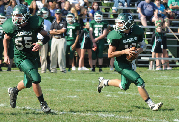 West Newbury: Pentucket quarterback Ryan Kuchar is escorted by lineman Chad Legault during the Sachem's home game against Danvers Saturday. Jim Vaiknoras/staff photo