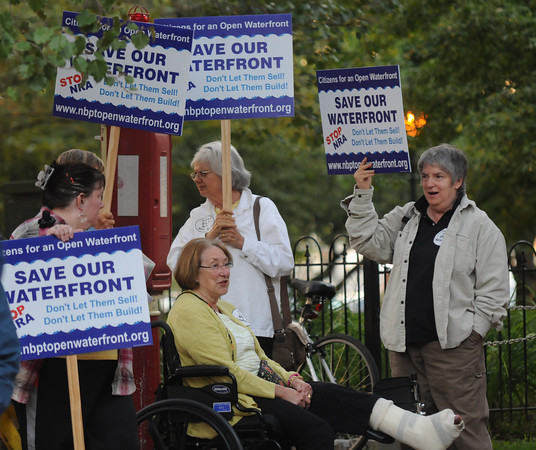 Newburyport: Members of COW, Citizens for an Open Waterfront, hold signs outside the Firehouse before the NRA meeting. JIm Vaiknoras/staff photo