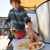 Newburyport: Pat Wieck of Salisbury, who works at the Arrowhead Farm, makes cider at the Newburyport Farmers Market's Apple festival Sunday morning. jim Vaiknoras/staff photo