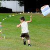 Amesbury: Ethan Scheri, 5, tries to get his kite to fly at Amesbury Park Sunday. Ethan had some help from his older brother Hunter.jim Vaiknoras/staff photo