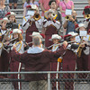 Newburyport:Newburyport Band director Steve Cohen conducts the marching band Friday night at the Clippers football game against Lynnfield at War Memorial Stadium in Newburyport. Jim Vaiknoras/staff photo