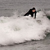 Salisbury: Chad Dixon of Newbury catches a wave as he surfs off Salisbury Beach Saturday. Jim Vaiknoras/staff photo
