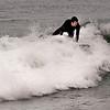 Salisbury: Chad Dixon of Newbury catches a wave as he surfs off Salisbury Beach Saturday. Jim Vaiknoras/staff photo