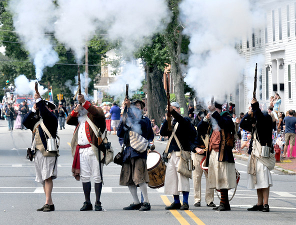 Newburyport: The Marblehead Regiment fires a volley at the Yankee Homecoming Parade Sunday.Jim Vaiknoras/staff photo