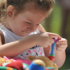 Newburyport: Kyleigh Johnson, 4, gives her bear a shot  at the Anna Jaques Hospital tent at Family Day at Maudslay Saturday. Jim Vaiknoras/staff photo