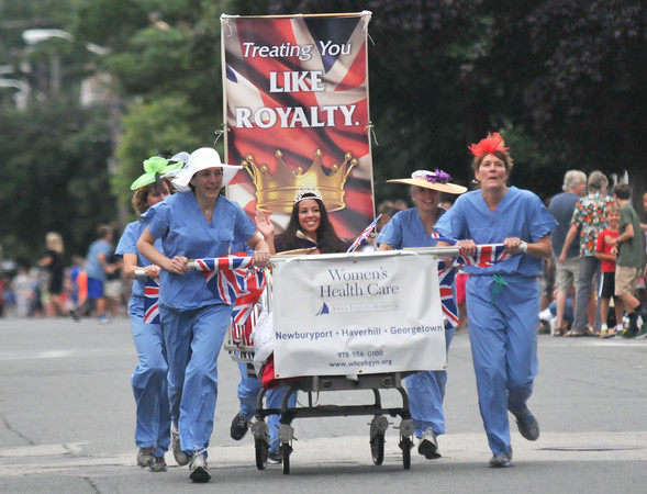 Newburyport: Woman's Health Care at Anna Jaques runs to the finish line in the Yankee Homecoming  Lions Club Bed Race on Federal Street Thursday night . Jim Vaiknoras/staff photo