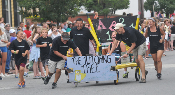 Newburyport: The Tutoring Tree team makes its way to the finish line in the Yankee Homecoming Lions Club Bed Race on Federal Street Thursday night. Jim Vaiknoras/staff photo