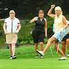 Newbury: Carol Farr of Melrose reacts as her golfball just misses the 9th hole at the Yankee Homecoming Golf Tournament at Ould Newbury Country Club. Teammates from left, Gayle McKinley, Newburyport; Robin Prentise, Newburyport, and out of view, Jo Buffum of Haverhill. Bryan Eaton/Staff Photo