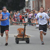 Newburyport: Bending the rules a bit too far, which led to disqualification, the Simply Sweet bed heads to the finish line in the Yankee Homecoming Lions Club Bed Race on Federal Street Thursday night. Jim Vaiknoras/