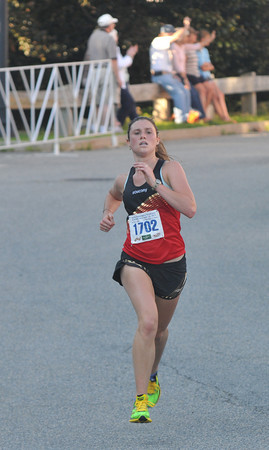 Newburyport:Woman's winner Alanna Poretta in the Yankee Homecoming 5k. Jim Vaiknoras/staff photo