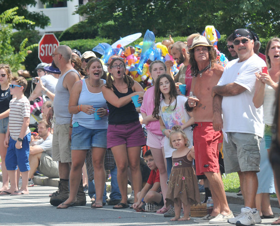 Newburyport: The Pond Street Irregulars, a fixture on High Street, watch the Yankee Homecoming parade Sunday. The parade party now on it's third generation and is now run my Jessie Knight, this years theme was My Generation. Jim Vaiknoras/staff photo