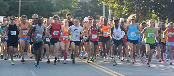 newburyport: Runner take off in the Yankee Homecoming 10 mile race Tuesday night. Jim Vaiknoras/staff photo