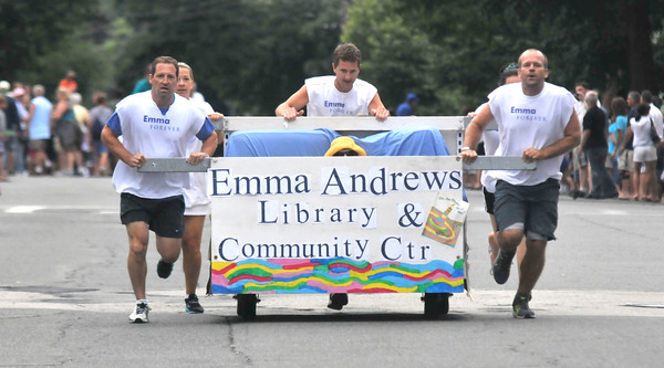 Newburyport: The Emma Andrews Library bed heads to the finish line in the Yankee Homecoming Lions Club Bed Race on Federal Street Thursday night. Jim Vaiknoras/staff photo