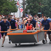 Newburyport: The Coast Guard sprints to the finish line in the Yankee Homecoming Lions Club Bed Race on Federal Street Thursday night. Jim Vaiknoras/staff photo