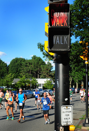 Newburyport: A traffic sign seems to be giving advice to runners in the Yankee Homecoming 5K Road Race. Bryan Eaton/Staff Photo