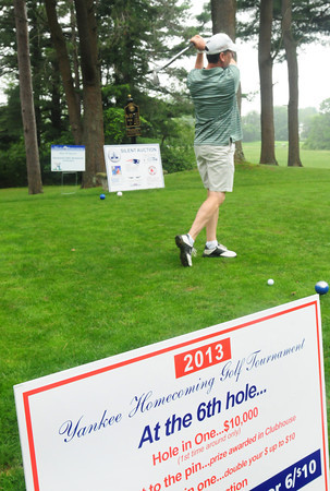 Newburyport: Newburyport native Mike Theriault, now of Stratham, tees off on the 6th hole hoping to get a hole-in-one and win $10,000. Bryan Eaton/Staff Photo