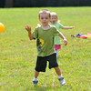 Newburyport: Justin Dube, 5, and his sister Haley, 2, run the YWCA fitness course at Family Day at Maudslay Saturday. Jim Vaiknoras/staff photo